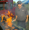 Dustin Shelton with Sagebruch Steak House has the steaks and burgers going on the grill during Tate of Tri-Cities. Photo by Ned Jilton II