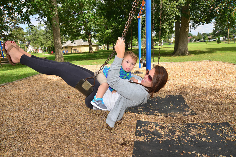 Melissa Stoffa and her son Brody Brooks take advantage of Wednesday's warm weather to make a trip to Borden Park.  Photo by David Grace