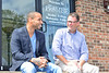 Reality show cast members Utopia Dave Green aka 5th Ave. Dave and Jonathan Lovelace talk on the seated on the steps of the Promise Church where Lovelace is a pastor. Photo by David Grace