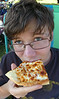 Zion Lindsey with the ever popular pizza at the Tates of Tri-Cities. Photo by Ned Jilton II