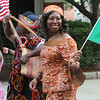 2014 Lowell Folk Festival. Ann Tsewole of Dracut, right, and Vighoti Tifah of Lowell, left, march with the Cameroonian group. (SUN/Julia Malakie)