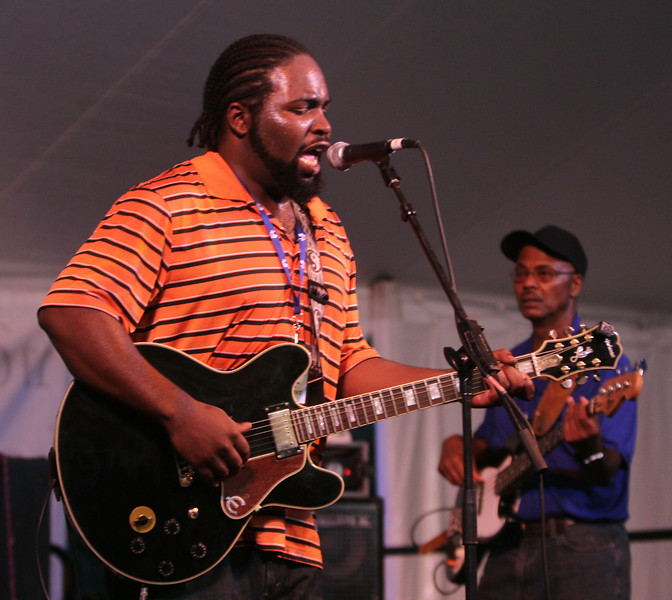 2014 Lowell Folk Festival. Marquise Knox, left, with Nephew Davis, right, on bass, perform blues at Dutton Street Dance Pavilion. (SUN/Julia Malakie)
