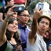 2014 Lowell Folk Festival. Lianna Kushi of Lowell and her friend Darion Ko of Los Angeles participate as everyone at Boarding House Park is instructed to take a 'selfie.' (SUN/Julia Malakie)