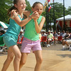 2014 Lowell Folk Festival. Caleigh Rendella, 8, left, and her friend Jenna Weene, 11, both of Wellesley, dance to the polka music of Bud Hundenski & the Corsairs at JFK Plaza.  (SUN/Julia Malakie)