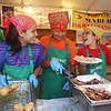 2014 Lowell Folk Festival. From left, Carsyn Fisher, 15, of Ayer, Edsel Camama, 13, of Natick, and Carsyn's brother Parker Fisher, 14, serve food at the Iskwelahang Pilipino booth at Boarding House Park. (SUN/Julia Malakie)