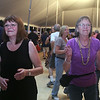 2014 Lowell Folk Festival. Fran Ahlstrom of Northfield, Vt., left, and her friend Karen Stewart of New Boston, N.H., dance to blues music of Marquise Knox at the Dutton Street Dance Pavilion. (SUN/Julia Malakie)