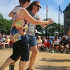 2014 Lowell Folk Festival. Christina Bland of Malden and her friend Paul Venditti of Pepperell dance to the polka music of Bud Hundenski & the Corsairs at JFK Plaza.  (SUN/Julia Malakie)