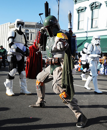 Star Wars bounty hunter Boba Fett (center) stops to strike a combat pose as the 501st Legion (Vader's Fist) group from Southwest Missouri marches during the Maple Leaf Parade Saturday morning, Oct. 19, 2013, on the Carthage Square. Globe | T. Rob Brown