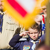 SAM HOUSEHOLDER | THE GOSHEN NEWS<br /> Maguire Alderman, 9, of Cub Scout Pack 704 salutes the flag during the national anthem Saturday at the Wakarusa Maple Syrup Festival parade.