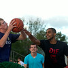 SAM HOUSEHOLDER | THE GOSHEN NEWS<br /> Nathan Hahaj, Dunlap, goes up for a shot against Rodney Lee, Cassapolis, Mich. during the three on three basketball tournament Wednesday at the Elkhart County 4-H Fair.