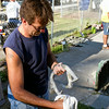 SAM HOUSEHOLDER | THE GOSHEN NEWS<br /> Greg Jones cleans his father's old horseshoes Wednesday between tosses at the Elkhart County 4-H Fair. Jones plays once a year at the fair.
