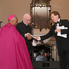 (L-r) Archbishop Wilton D. Gregory and Cathedral of Christ the King pastor Father Frank McNamee accept the City of Atlanta Phoenix Award from Dave Fitzgerald on behalf of Mayor Kasim Reed.  (Page 28, February 28, 2013)