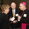 Mickie and Don Keough greet Auxiliary Bishop of Atlanta Luis Zarama during the Cathedral of Christ the KIng's 75th anniversary gala.
