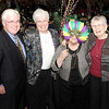 (L-r) Frank Crosby joins Dominican Sisters Elizabeth Sully, Nora Ryan (behind mask) and Patricia Caraher during a moment of fun at the centennial anniversary gala.   (Page 28, February 28, 2013)