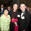 Annie and Raul Trujillo join Atlanta Auxiliary Bishop Luis Zarama during the Cathedral of Christ the King's 75th anniversary gala. The Trujillos were married at the Cathedral of Christ the King 48 years ago.