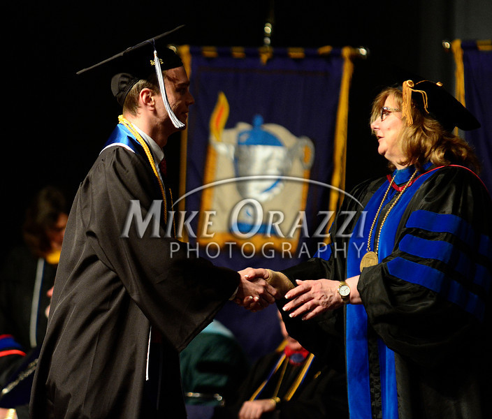 5/17/2014 Mike Orazzi | Staff<br /> CCSU student Austin Swan during Saturday's graduation ceremony at the XL Center in Hartford.