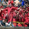 "6/27/2014 Mike Orazzi | Staff<br /> New Britain High School Dylan Krivickas leads a ""I believe we will win"" chant during Friday's graduation ceremony at New Britain Stadium."