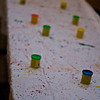 I created tablecloths from paper drop cloths that the kids & I splattered with paint.  A fun (and messy!) project.  This is the craft table.