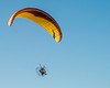 Backpack Powered Parachute flying over the ocean
