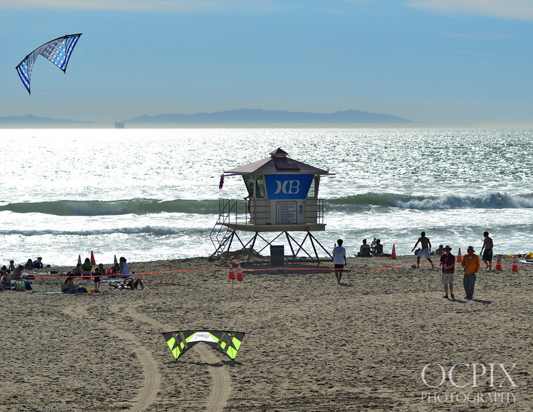 Kite Party in Huntington Beach - Saturday March 8, 2014. Event is sponsored by The Kite Connection. Pro kite flyers come from all over the country to show their skills over the beautiful beach is Southern California on the north side of the HB Pier.