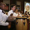 Lowell Community Charter Public School hosts a memorial event, with the African Cultural Association of Greater Lowell, in honor of Nelson Mandela. The LCCPS Drumming & Percussion group, including Swaleh Kasujja, left, and Nicholas Cruz, second from left, performs. (SUN/Julia Malakie)