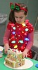 Brecknock Elementary School hosts their annual Gingerbread House making on Friday, Dec. 5. Here Megan Pettinato, 7, Mohnton, wears holiday lights while crafting her gingerbread home. Emily Thiel - 21st Century Media
