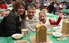 Brecknock Elementary School hosts their annual Gingerbread House making on Friday, Dec. 5. Pictured here are (left to right) Jen Kloc, Derek Kloc, 12, and Jillian Kloc, 8, Brecknock Township. Emily Thiel - 21st Century Media