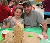 Steve Palange and Tessa Palange, 7, Mohnton, at the annual Gingerbread House making. Emily Thiel - 21st Century Media