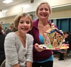 Wendy Collins and Emma Collins, 8, Maple Grove, at the Brecknock Elementary School  their annual Gingerbread House making on Friday, Dec. 5. Emily Thiel - 21st Century Media