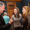 Official farewell party for outgoing Lowell city manager Bernie Lynch. Bernie Lynch talks with Mill City Grows co-directors Francey Slater, center, and Lydia Sisson, right, both of Lowell. (SUN/Julia Malakie)