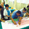 CEBU. Officials of government and nongovernment organizations join Metro Cebu Water District's Ernie Delco (left) and Lasaro Salvacion (second from left) in making a pledge to work together to implement integrated water resource management in Metro Cebu. To signify their pledge, they sign a map of the Central Cebu Protected Landscape, a conglomeration of three major watersheds that supply water to Metro Cebu's aquifers. (Liberty Pinili/Sun.Star Cebu)
