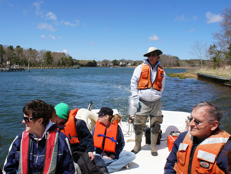 RUSSELL L FRAYRE<br /> 5111<br />  Captain Tom Marcotti guides a group of attendees on a tour of Prince Cove.  Where the fresh meets the salt water and where our fragile enviorment is at risk. We saw Osprey, clams and so much more. A highlight of the Marstons Mills River Day celebration.  Seated left to right, Susan Davis of Centerville, Trey Toby, age 10 of Centerville, Noah Vecchione, age 8 of Centerville , Laurie McDavid of Centerville, and Bob Taroni<br /> of Marstons MIlls.