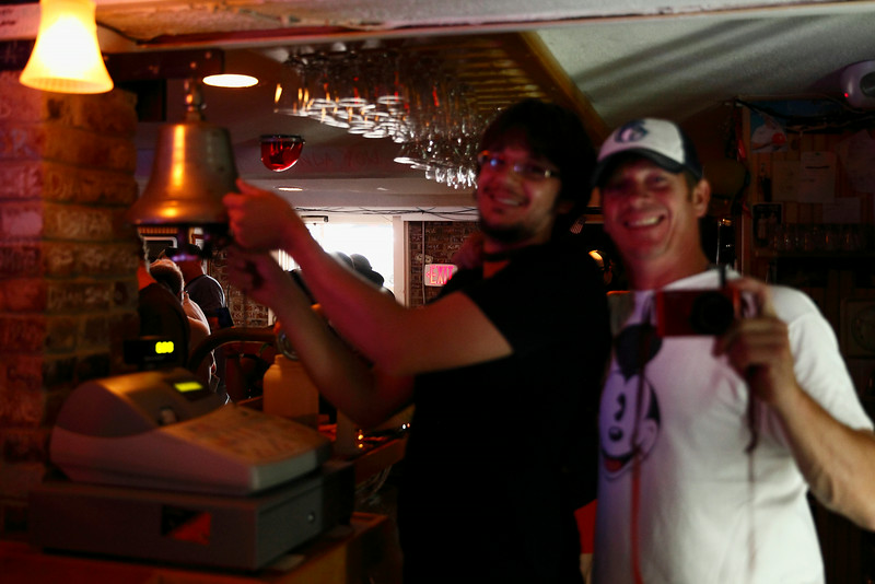 "27 July 2014 Old Orchard Beach,ME-Jon Stoltzfus of Atlas Gray and Keith O'Leary behind the bar at One Soho Square.  Jon manned the bell for ""Maxwell's Silver Hammer"" played during the Sunday afternoon and evening Beatles/Wings tribute performance led by Denny Laine of Wings and Peter Gordon of British duo Peter & Gordon."