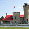 With its impressive buff-colored brick walls, large square tower topped with battlements, and elegant fourth order Fresnel lens, this lighthouse-built in 1892-is a source for inspiration. Old Mackinac Point Lighthouse, Mackinac, Michigan,connecting the upper and lower Michigan.