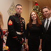 State Rep. Jim Arciero hosts his third annual Sun Santa/Toys for Tots fundraiser, at the Franco American Club in  Westford. From left, Nancy Cook of Westford, Marine Sgt. Gregory Yarbrough of Fort Devens, Bridget Arciero and State Rep. Jim Arciero, D-Westford. (SUN/Julia Malakie)