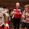 State Rep. Jim Arciero hosts his third annual Sun Santa/Toys for Tots fundraiser, at the Franco American Club in  Westford. Steven Ducharme and Anne Connell, vice president of the Franco American Club, both of Westford, check out the raffle items. (SUN/Julia Malakie)
