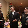 State Rep. Jim Arciero hosts his third annual Sun Santa/Toys for Tots fundraiser, at the Franco American Club in  Westford. From left, Marine Sgt. Gregory Yarbrough of Fort Devens, State Rep. Jim Arciero, D-Westford, and Brad Lamy of Westford. (SUN/Julia Malakie)