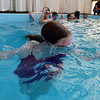 Caitlyn McFarlane, 12, blows bubbles under the water while participating in the World's Largest Swim Lesson at the Broomfield Academy on Thursday.<br /> <br /> June 14, 2012 <br /> staff photo/ David R. Jennings