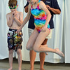 Sydney Wagner, 12, jumps into the pool during the World's Largest Swim Lesson at Broomfield Academy on Thursday.<br /> <br /> June 14, 2012 <br /> staff photo/ David R. Jennings