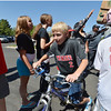 Jonah Cox, 11, rides a donated bicycle to the storage area while helping  unload a semi truck from Ball Corp. with 5,000 cubic feet of sports equipment for the Jessica Redfield Ghawi giveSports Scholarship Fund at A Precious Child on Saturday. September 8, 2012 staff photo/ David R. Jennings