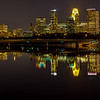 Mississippi Mirror - wider angle.  The Minneapolis skyline, from the Guthrie theater and Hennepin Avenue bridge to the Target building and the well-lit riverside parks is perfectly reflected in the glass-like surface of the MIssissippi river.