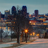 The twilight skylines of the twin cities of Minneapolis and Saint Paul can be seen in this image captured from high on the bluffs on the east bank of the Mississippi river in St. Paul, Minnesota