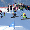 Men's semi final #1 of the Team SBX event at Montafon, Austria with Konstantin Schad (GER) in yellow leading ahead of Markus Schairer (AUT) in blue and Michele Godino (ITA) in green<br /> <br /> @ FIS