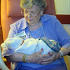Mom holding her Great Granddaughter Ashby