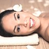 bautiful smiling woman lying down for spa treatment