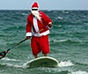 Santa rides the waves in Fort Lauderdale, Florida, US