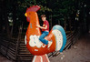 Jonathon riding a wooden Dala Rooster at Skansen - (July 15, 1989 / Djurgården, Stockholm, Sweden) -- Jonathon