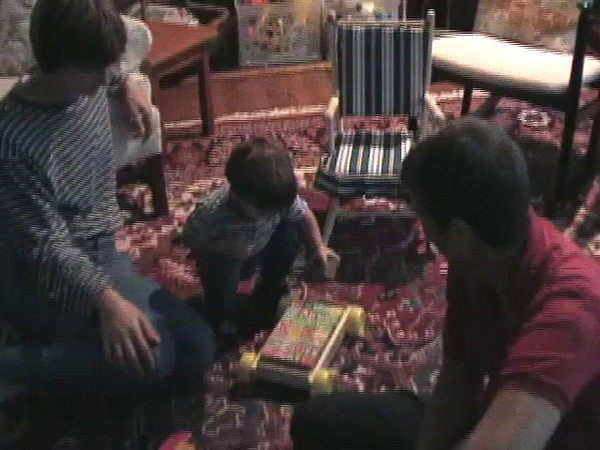 2003-10-11 - Ian with jigsaw puzzle, ringing bell, responding to Orff children's music