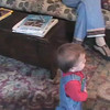 2003-2-14 - Ian pointing at cat on Martha's lap, playing with butterfly toy