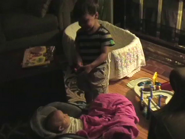 2004-9-17 - Ian showing Sarah his dump truck and play-dough